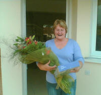 Delivering a bouquet of flowers and a box of chocolates in Aradipou Cyprus