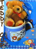 teddy bear in a mug for delivery in Cyprus with flowers and plants