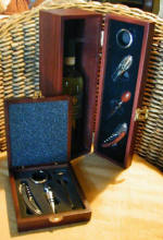 Wine presentation gift boxes - you may send wine or champagne in these sleek boxes. Vintners tools are included.
